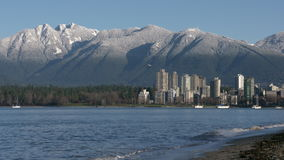 Vancouver Towers, Mountain Snow, Kitsilano 4K. Kitsilano Beach in the early morning. In the background are the snowcapped North Shore Mountains. Vancouver stock video