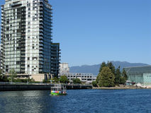 Vancouver water taxi heading to. Waterfront scene in Vancouver. A water taxi in the False Creek area Stock Photography
