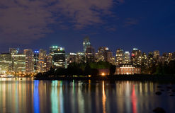 Vancouver waterfront at night. A nighttime panoramic view of the waterfront and skyline of Vancouver, British Columbia, Canada Stock Image