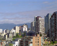 Vancouver West End BC Canada. Vancouvers West End with the Coast mountains in the background royalty free stock photo