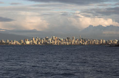 Vancouver wide skyline with building clouds. Wide Skyline shot from Spanish Banks in late afternon with building clouds - Vancouver, British Columbia stock photo