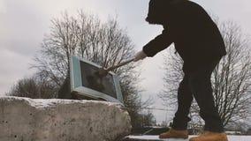 Vandal breaks a sledgehammer the tv. Slow motion video stock video