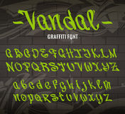 Vandal Graffiti Font. Set of graffiti style letters on brick wall background with abstract graffiti arrows. Vector alphabet. Old school graffiti glyphs Stock Images