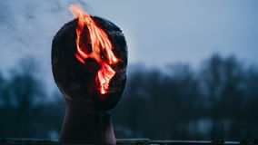Vandal sets fire to the head of the dummy. Closeup video stock video