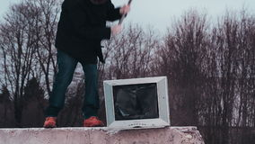 Vandal with a sledgehammer breaking tv. Close up video stock video