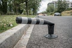 Vandalised Black Bollard with reflectors stock photography