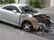 Vandalism in Berlin. MAY 8, 2013 - BERLIN: a burned out Audi TT sports car in the Friedrichshain district of Berlin - vandalism acts like this have become a Stock Photos