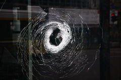 Vandalism in Berlin. A vandalized window with the trace of gunshot, Berlin Stock Image