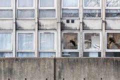 Vandalism, broken windows of a dilapidated council flat housing. Block, Robin Hood Gardens, in East London stock photos