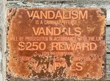 Vandalism warning sign stock images