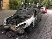 Vandalized car. CIRCA AUGUST 2013 - BERLIN: a burned out car in the Wedding district of Berlin - vandalism acts like this have become a common sight in Berlin Stock Images