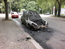 Vandalized car. CIRCA AUGUST 2013 - BERLIN: a burned out car in the Wedding district of Berlin - vandalism acts like this have become a common sight in Berlin Royalty Free Stock Photos