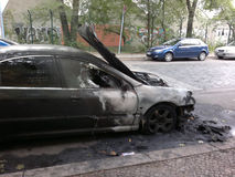Vandalized car. CIRCA AUGUST 2013 - BERLIN: a burned out car in the Wedding district of Berlin - vandalism acts like this have become a common sight in Berlin Stock Image