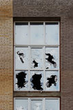 Vandals smashed the glass of windows of the an unfinished shopping mall, which was left without protection. Stock Photo