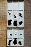 Vandals smashed the glass of windows of the an unfinished shopping mall, which was left without protection. Royalty Free Stock Images
