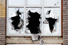 Vandals smashed the glass of windows of the an unfinished shopping mall, which was left without protection. Stock Image