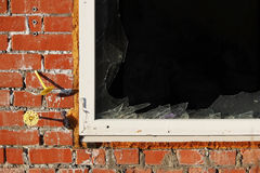 Vandals smashed the glass windows of the unfinished unguarded abandoned building of the shopping complex. Royalty Free Stock Images