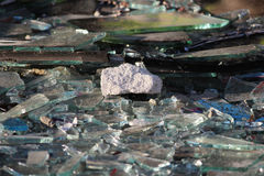 Vandals smashed the glass windows of the unfinished unguarded abandoned building of the shopping complex Royalty Free Stock Images