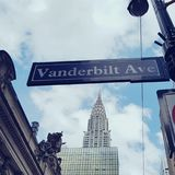 Vanderbilt Avenue, New York City, NY. Vanderbilt Avenue sign next to Empire State Building skyline in New York City, NY Stock Image