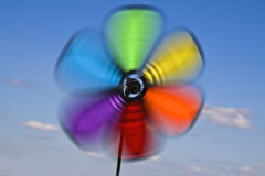 Vane. Colorful image of a vane in motion against a cloudy sky royalty free stock images