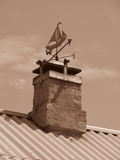 Vane. Attached to the chimney on the roof Stock Photography