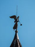 Vane. Weather vane in the form of an angel with a trumpet on the tower of the monastery royalty free stock photo