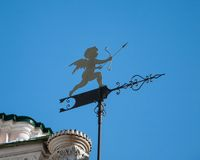Vane. Weather vane in the form of cupid with arrow stock photo