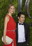Vanessa Axente and Joseph Altuzarra at the 2015 Tonys. Model Vanessa Axente and designer Joseph Altuzarra arrive on the red carpet for the 69th Annual Tony Stock Image