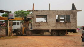 VANG VIENG, LAOS - APRIL 2014: carrying instant house. By a truck stock video