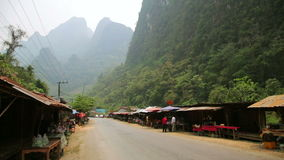 VANG VIENG,LAOS - APRIL 2014: local market on valley. Day time stock footage