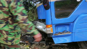 VANG VIENG, LAOS - APRIL 2014: Traffic accident. Truck hit tree on intercity road stock footage