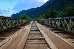 Vang Vieng in Laos countryside old wooden bridge stock images