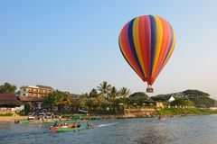 Vang Vieng, Laos - February 15, 2016 : Hot air balloon over Nam Song river. Vang Vieng is a tourist attraction town. Vang Vieng, Laos Royalty Free Stock Images