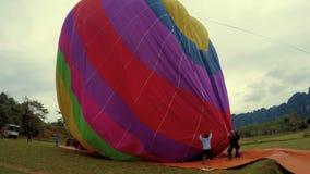 Vang Vieng, Laos - 22 January 2016: Blowing Off Hot Air Baloon. Blowing Off Hot Air Baloon in Vang Vieng stock video footage