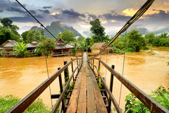 Vang Vieng Laos landmark and wooden brigde Royalty Free Stock Images