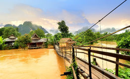 Vang Vieng Laos landmark and wooden brigde Royalty Free Stock Image