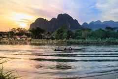 Kayaking on the Mekong River in the picturesque village of Vang Vieng royalty free stock images