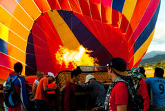Vang Vieng, Laos - November 21, 2015: Hot air balloon being inflated in Vang Vieng, Laos Royalty Free Stock Images