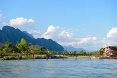 Vang Vieng, Laos - November 13, 2014 : Toursit activies with wooden bridge over Song river in Vangvieng, Vang Vieng is a tourist. Attraction town in northern Stock Photos