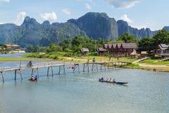 Vang Vieng, Laos. Wooden bridge across Nam Song river at Vang Vieng, Laos royalty free stock photo