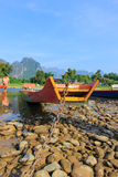 Vang Vieng -a tourist-oriented town in Laos in Vientiane Province. lies on the Nam Song River.. The most notable feature of the area is the karst hill landscape Stock Photo