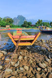Vang Vieng -a tourist-oriented town in Laos in Vientiane Province. lies on the Nam Song River.. The most notable feature of the area is the karst hill landscape Royalty Free Stock Photo