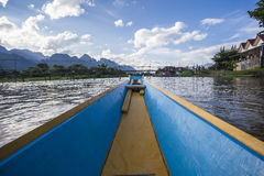 Vang Vieng  Vientiane Laos wooden boat river Royalty Free Stock Photos