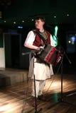 Vanghele Gogu que canta en bayan Imagen de archivo libre de regalías