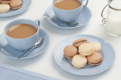 Vanilla And Chocolate Macarons With Tea Royalty Free Stock Images