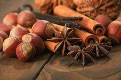 Vanilla, anisetree. Closeup of anise, cinnamon and vanilla pods on brown background Stock Photo