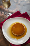 Vanilla bean flan and champagne. Vanilla bean flan and a glass of champagne Stock Image