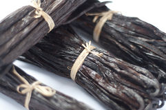 Vanilla bean stack. Shot of 4 bunches of vanilla beans against a white background Royalty Free Stock Image