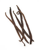 Vanilla beans. Five vanilla beans on a white background Royalty Free Stock Photography