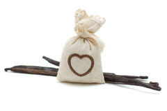 Vanilla beans and bag of aroma herbs Royalty Free Stock Image